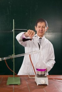 A chemistry teacher conducting an experiment in a classroom